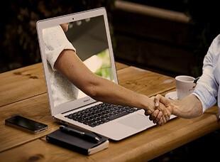 handshake-hands-laptop310 228